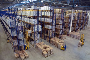 Interior large warehouse with freight stacked high.