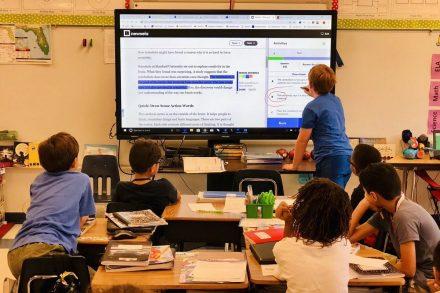 A classroom utilizes Newsela