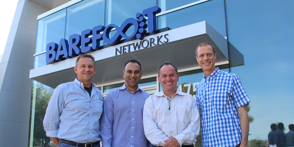 Photo caption: From left: Nick McKeown, co-founder, chief scientist and chairman of Barefoot Networks; Navin Shenoy, Intel executive vice president and general manager of the Data Center Group; Bob Swan, Intel chief executive officer; and Craig Barratt, Barefoot Networks chief executive officer, stand outside Barefoot Networks' headquarters after the announcement of Intel's acquisition of the Santa Clara, California, company on Monday, June 10, 2019. (Credit: Barefoot Networks)