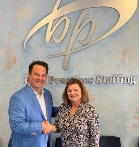 PeopleShare co-founder Dave Donald and Best Practices Staffing owner Betty Myers shake hands to seal the deal on the acquisition