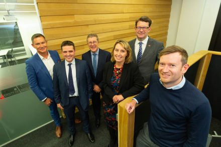 The pic shows Joe Cusdin, front, with, back left to right, Taming the Dragon event organizer Russell Copley, Ed Capes of Fraser Brown, Pat Doody and Samantha Harrison of Greater Lincolnshire LEP, and Lewis Stringer of the British Business Bank.