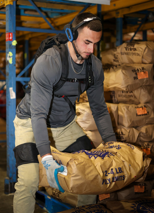 A Warehouse worker wearing Verve Motion's exosuit. Photo courtesy of ADUSA Distribution